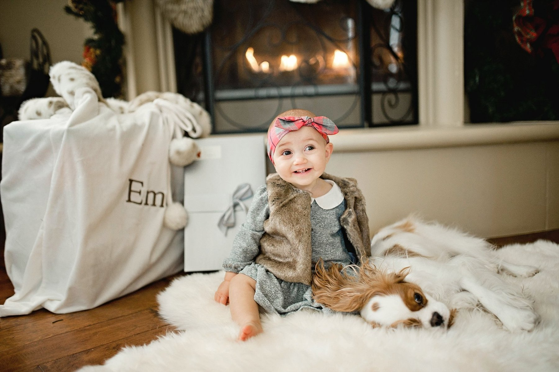 Christmas photo of girl and puppy by Erica Williams