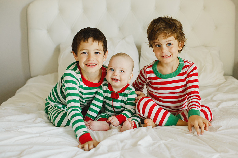 Christmas pic of boys in their striped holiday pajamas by Lauren Harris