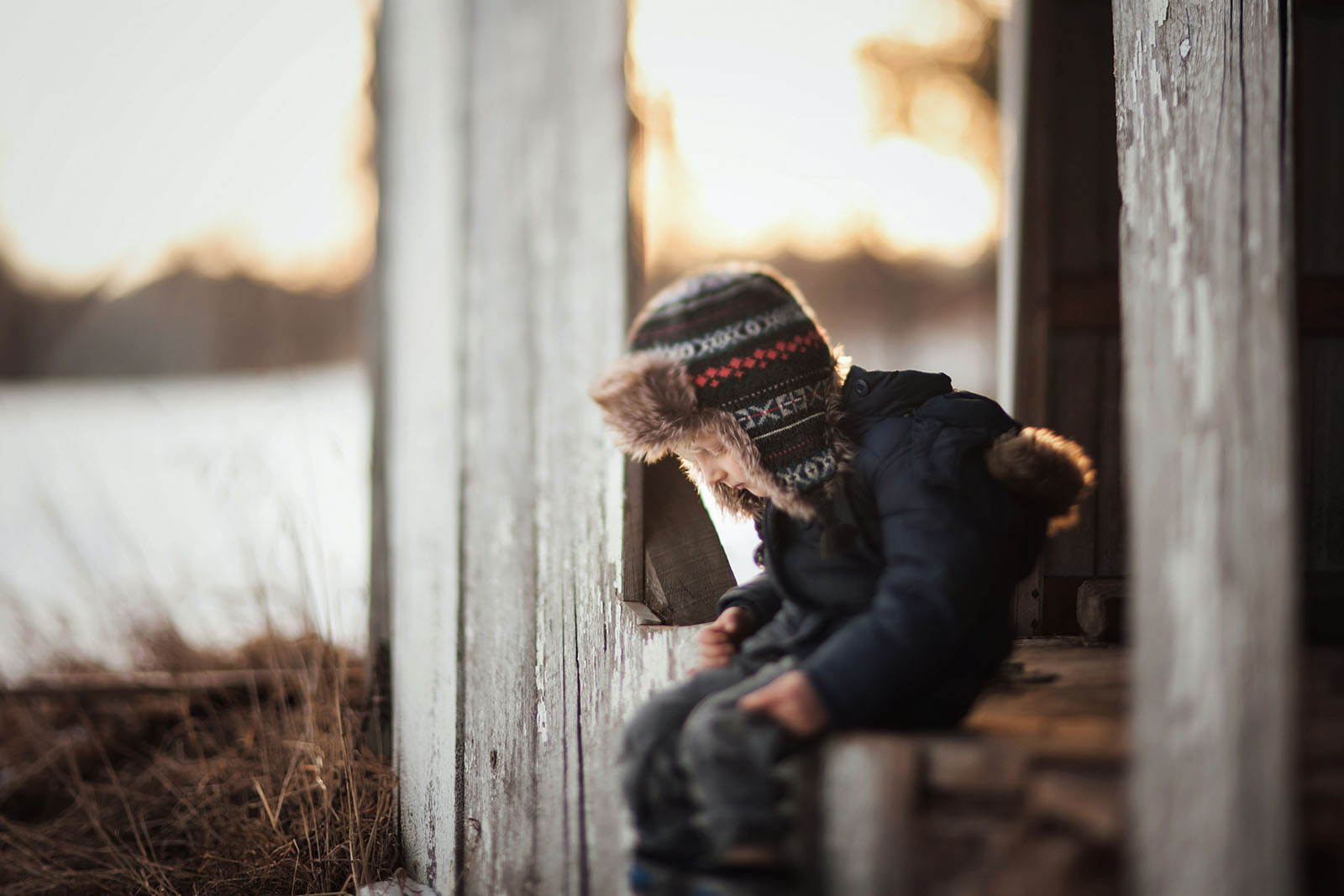 freelensed picture of boy sitting by Meg Loeks