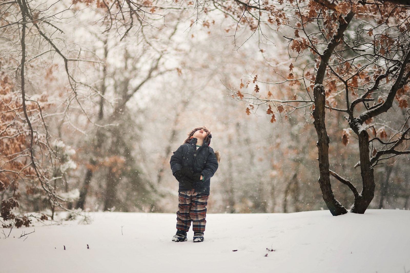 photo of boy tasting falling snow by Meg Loeks