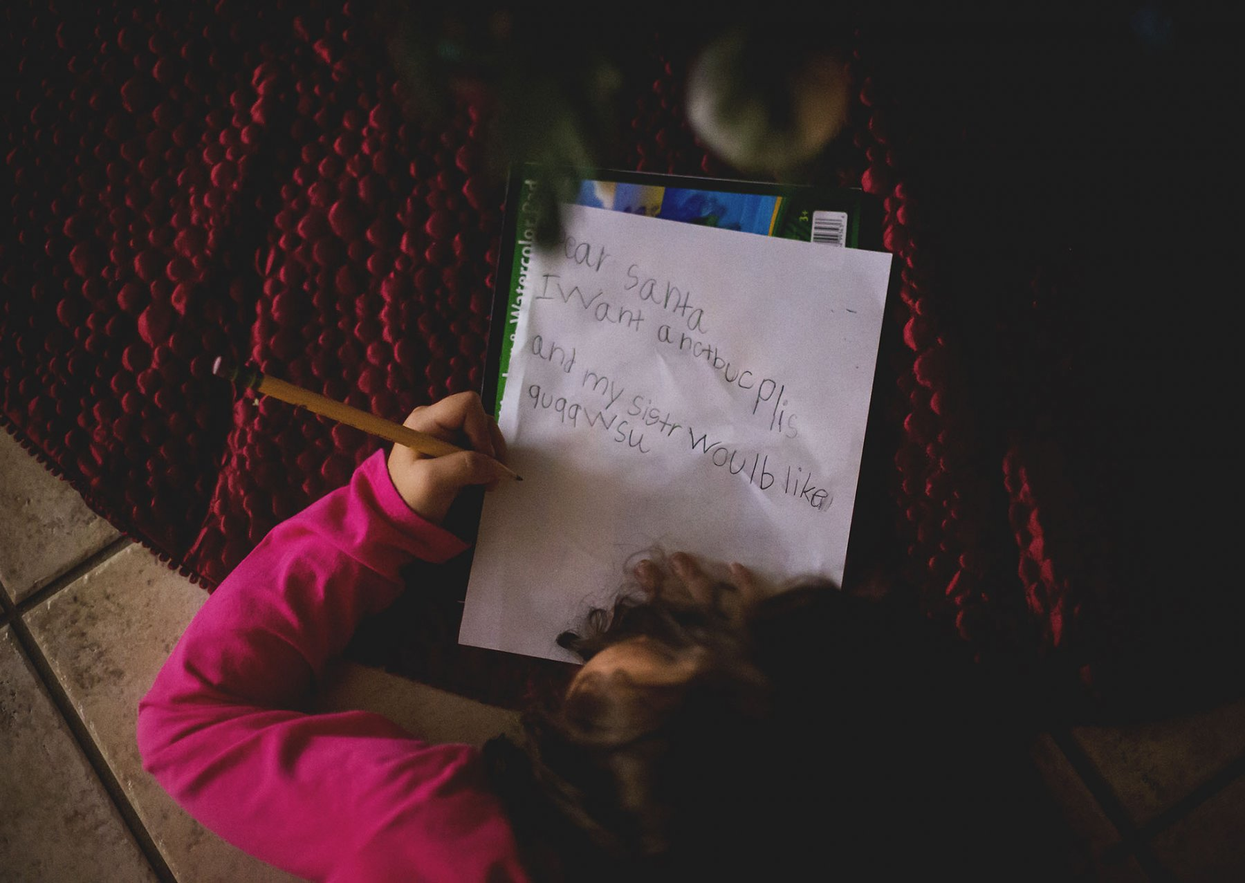 photo of girl writing a letter to Santa by Elizabeth Ordonez