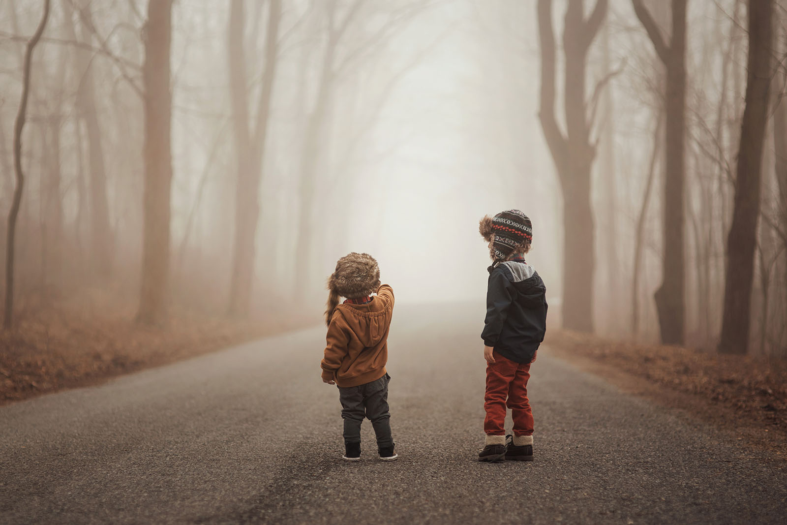 photograph of brothers walking down a road by Meg Loeks