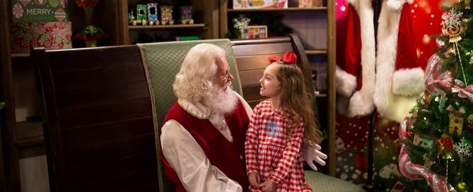 picture of girl sitting on Santa's lap by Marcie Reif