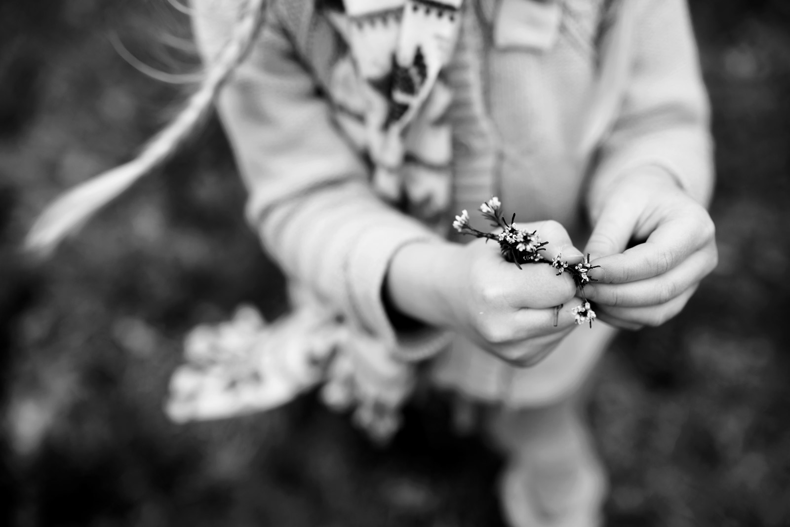 Black And White Pic Of Child Holding Wild Flowers By Cynthia Dawson