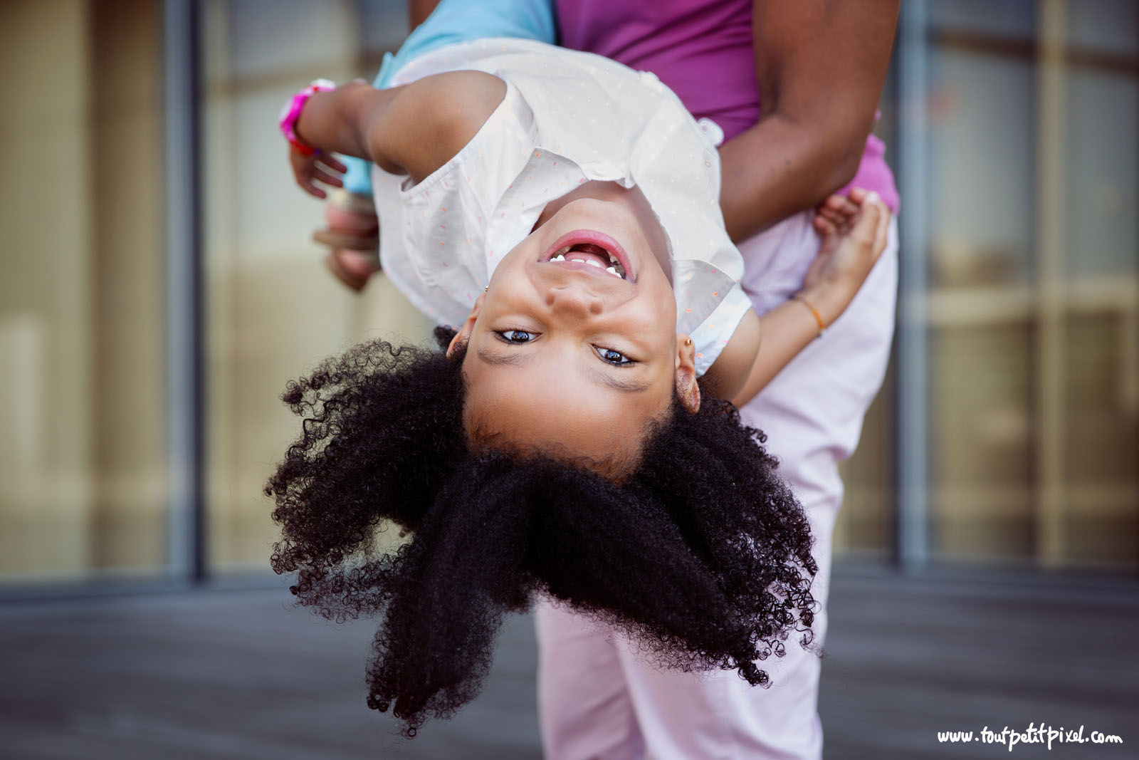 The secret to getting natural, happy images of children is simply to forget about making them pose. It doesn't mean that you won't be guiding them at all, though. It means that instead of telling them how to sit or stand, you are going to give them something to DO.