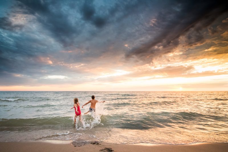 Shooting at the beach in the summer is one of my favorite ways to capture summer memories for my family. With strong backlighting, we often have to pick what we want to expose correctly - our subjects or the sky. This is how I edit those potentially difficult photos.