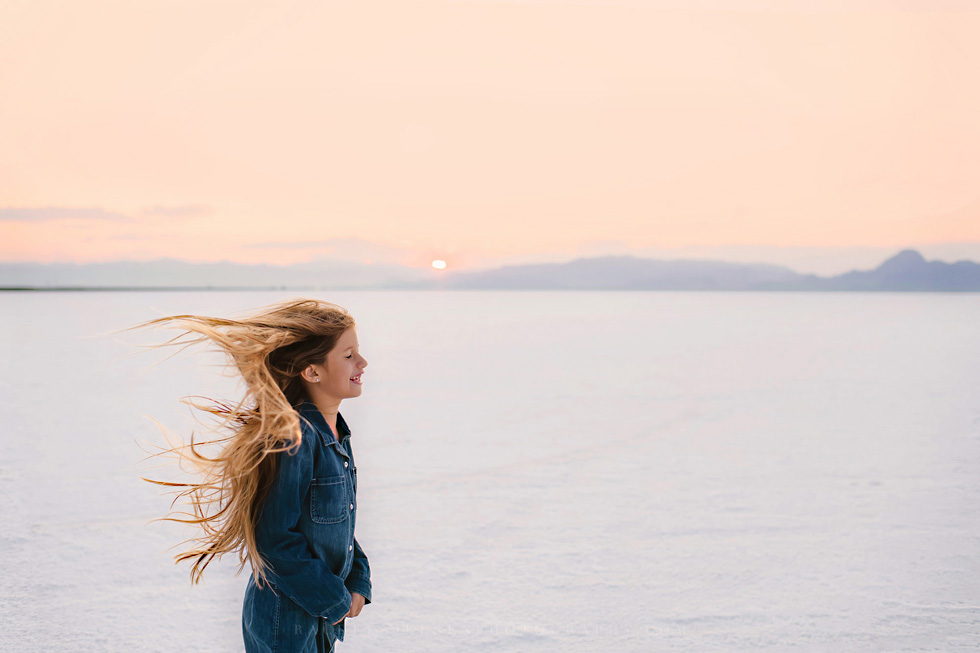 girl with her hair blowing in the wind by Rachel Nielsen