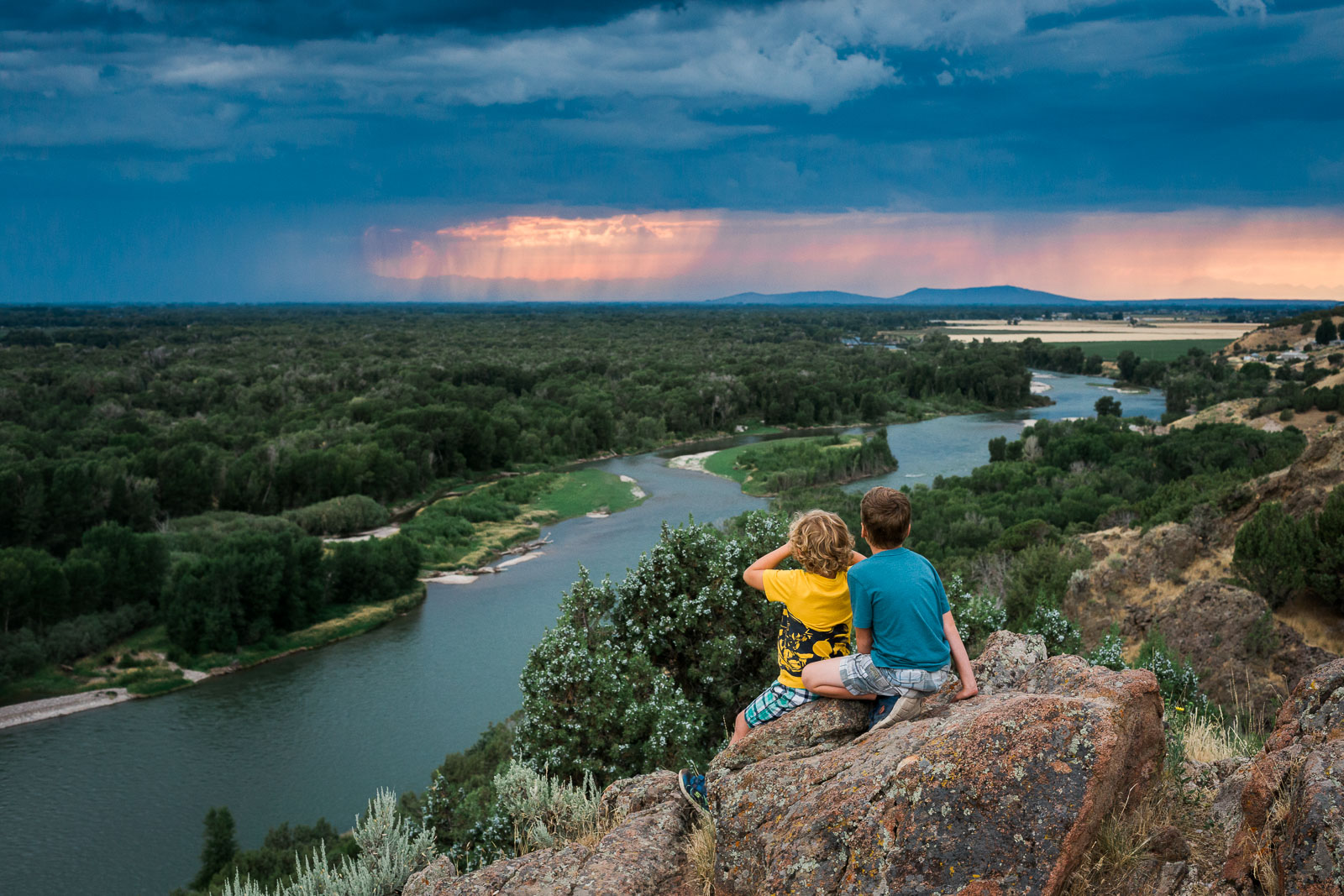 pic of two brothers on a mountain looking at the view by Jessie Nelson