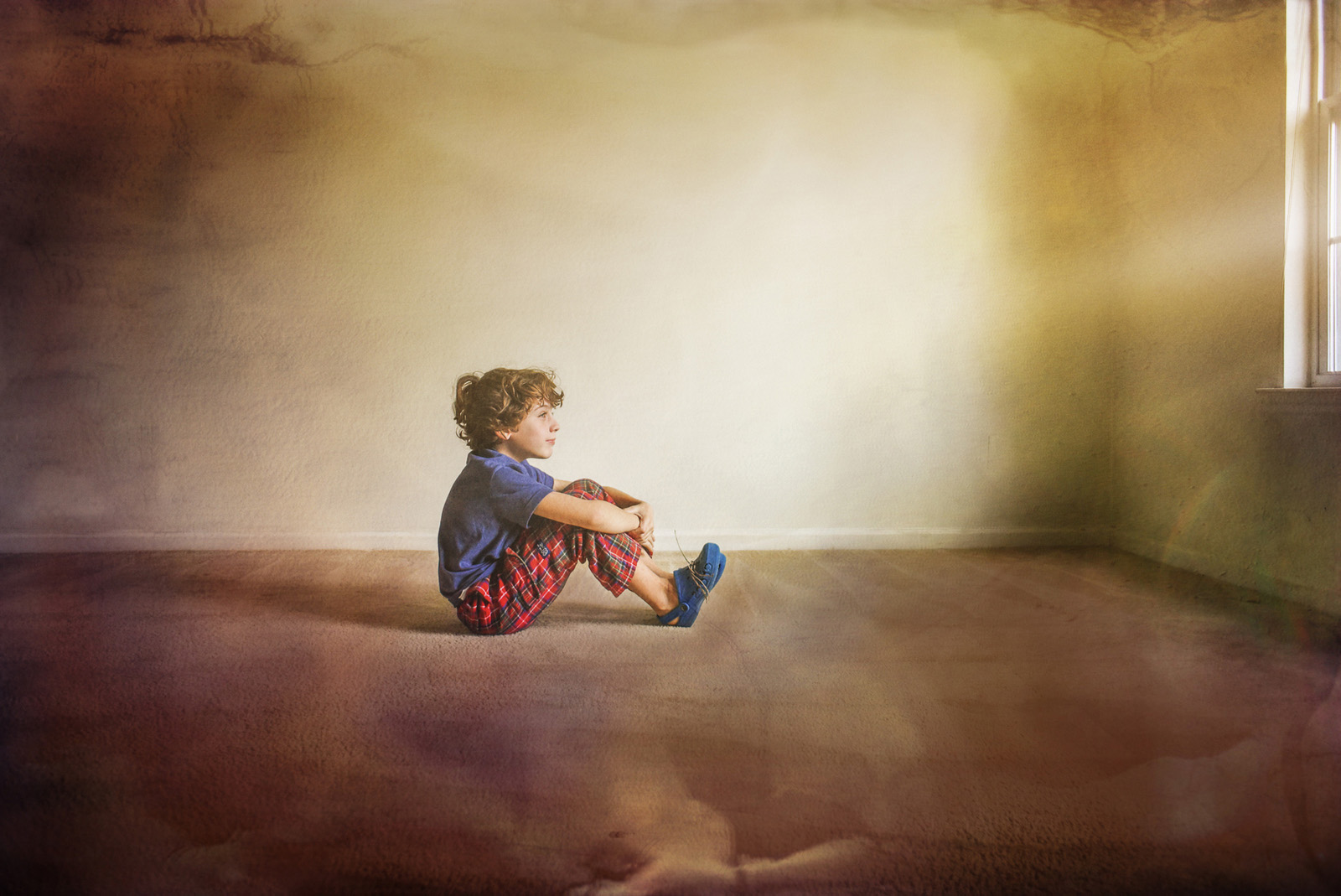 photo of boy sitting on the floor by Jan Tyler