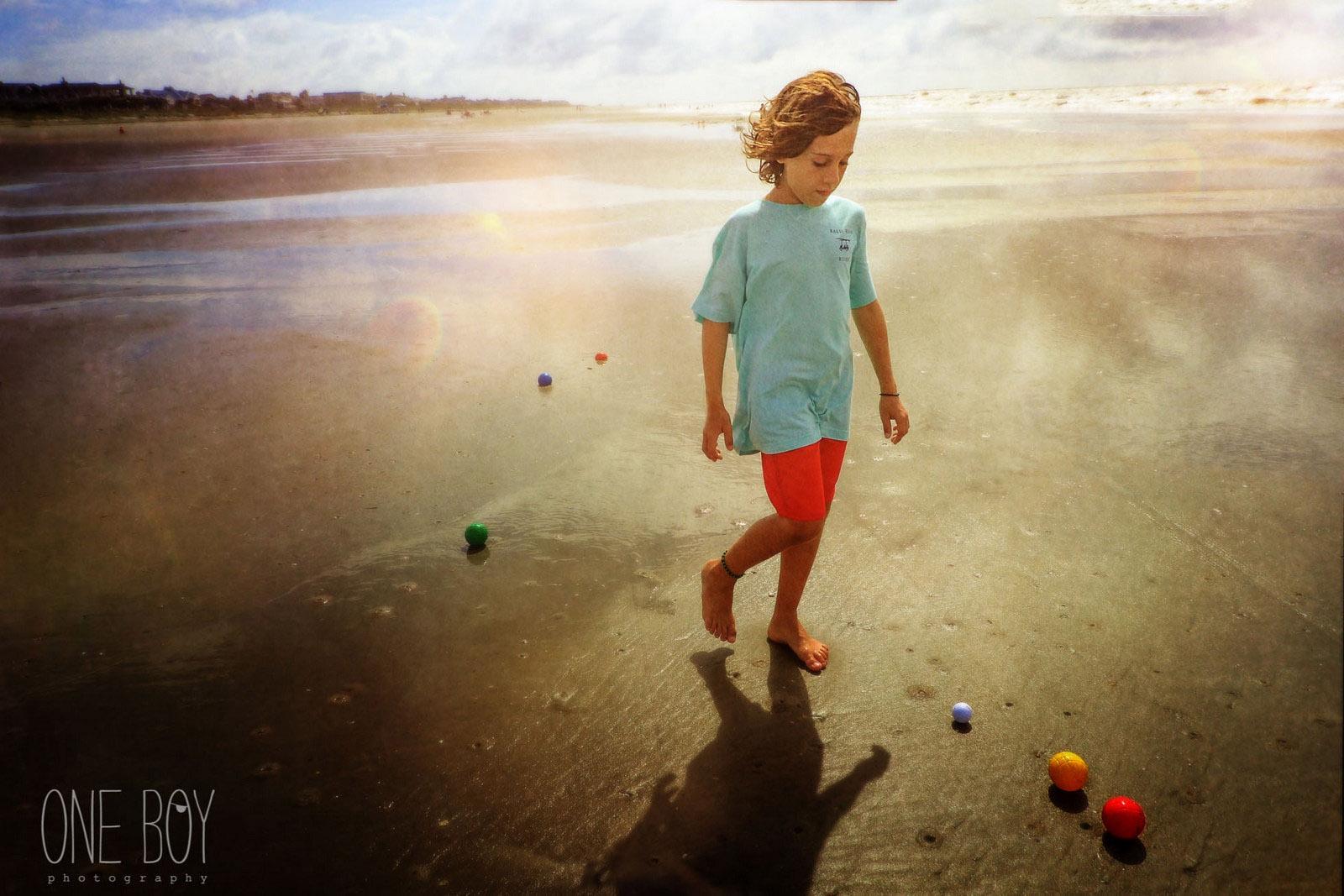 photo of boy walking on the beach by Jan Tyler