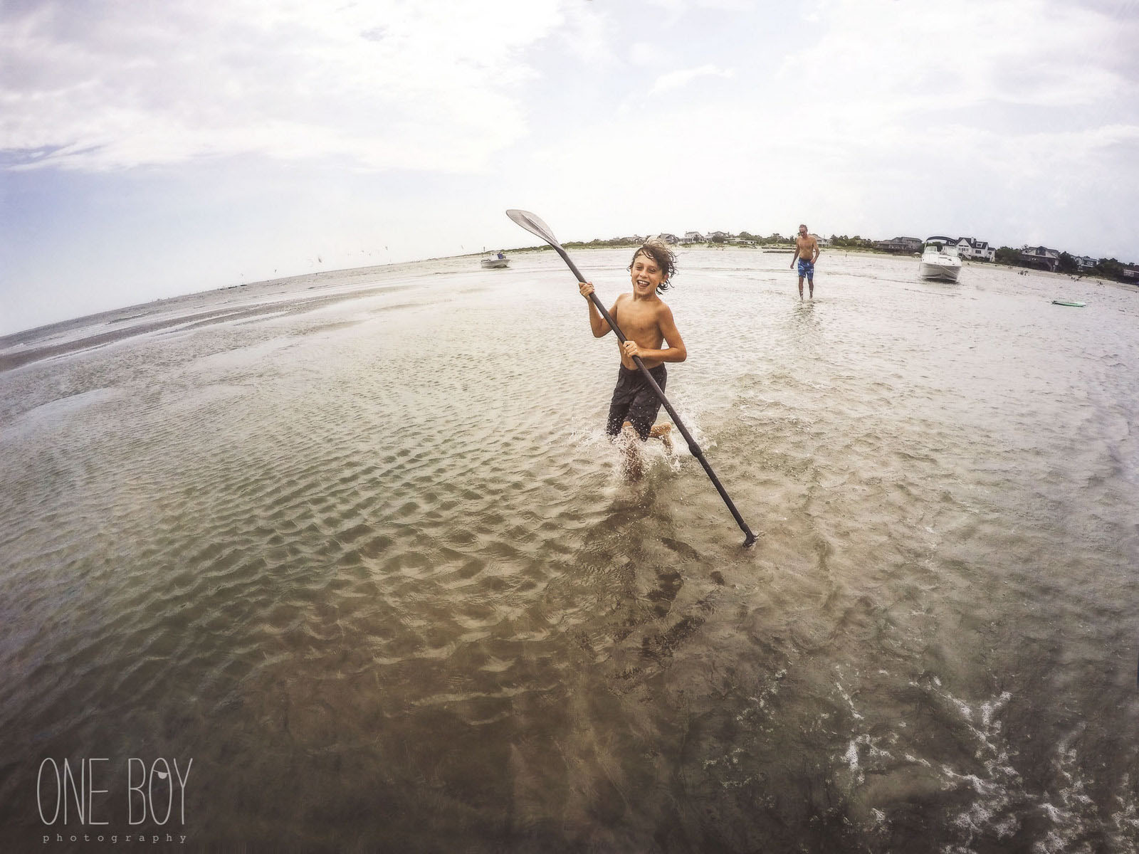 picture of boy playing in the ocean by Jan Tyler