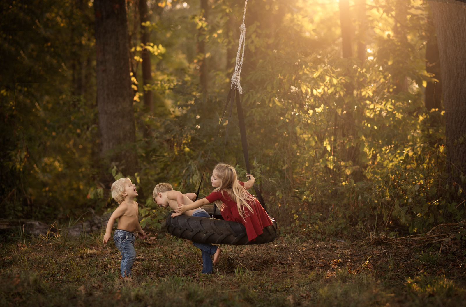 photo of three siblings playing by Danielle Awwad