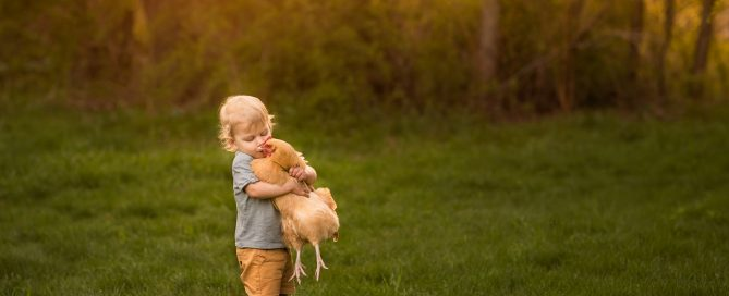 pic of boy giving a chicken a kiss by Danielle Awwad