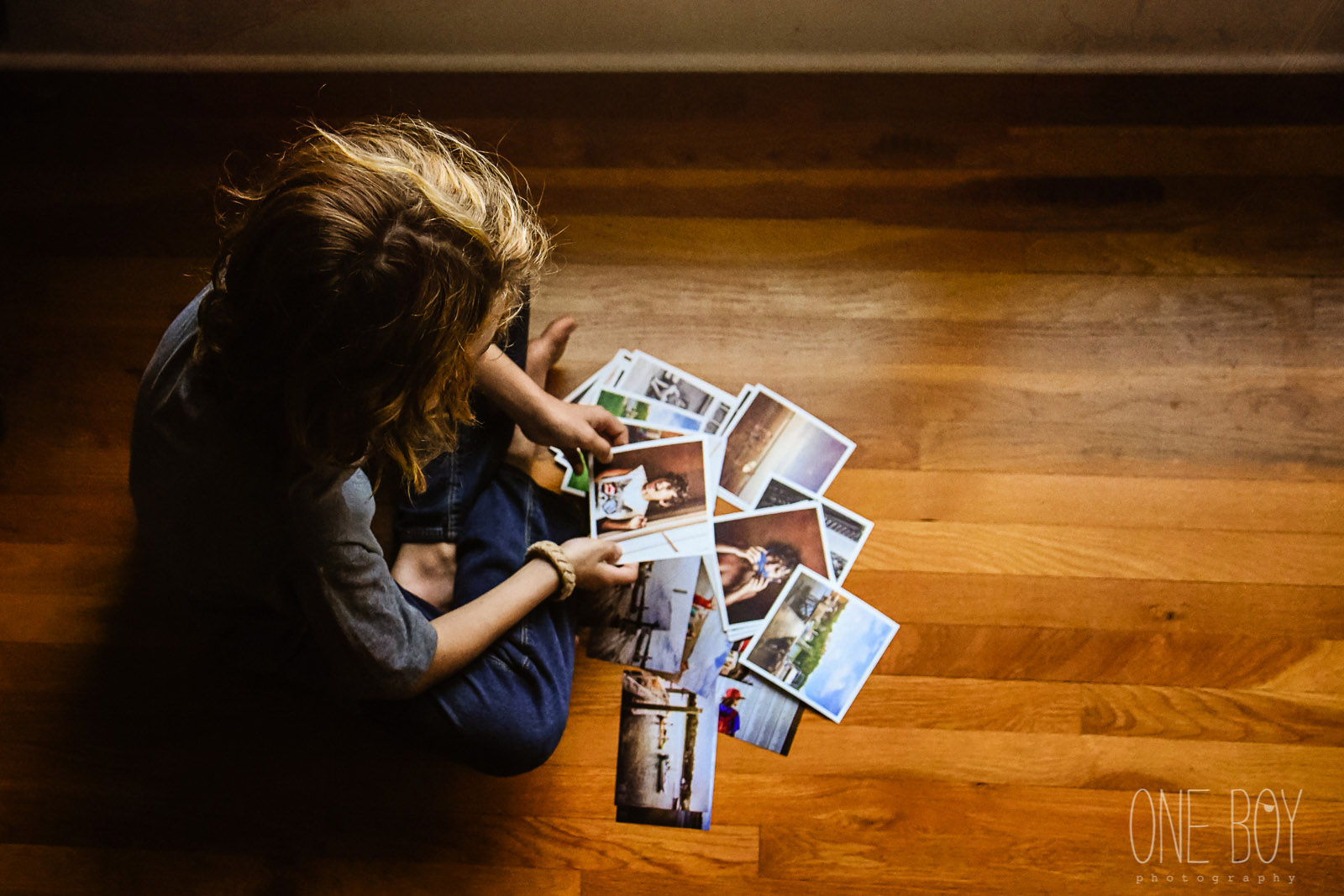 pic of boy looking at printed photos by Jan Tyler