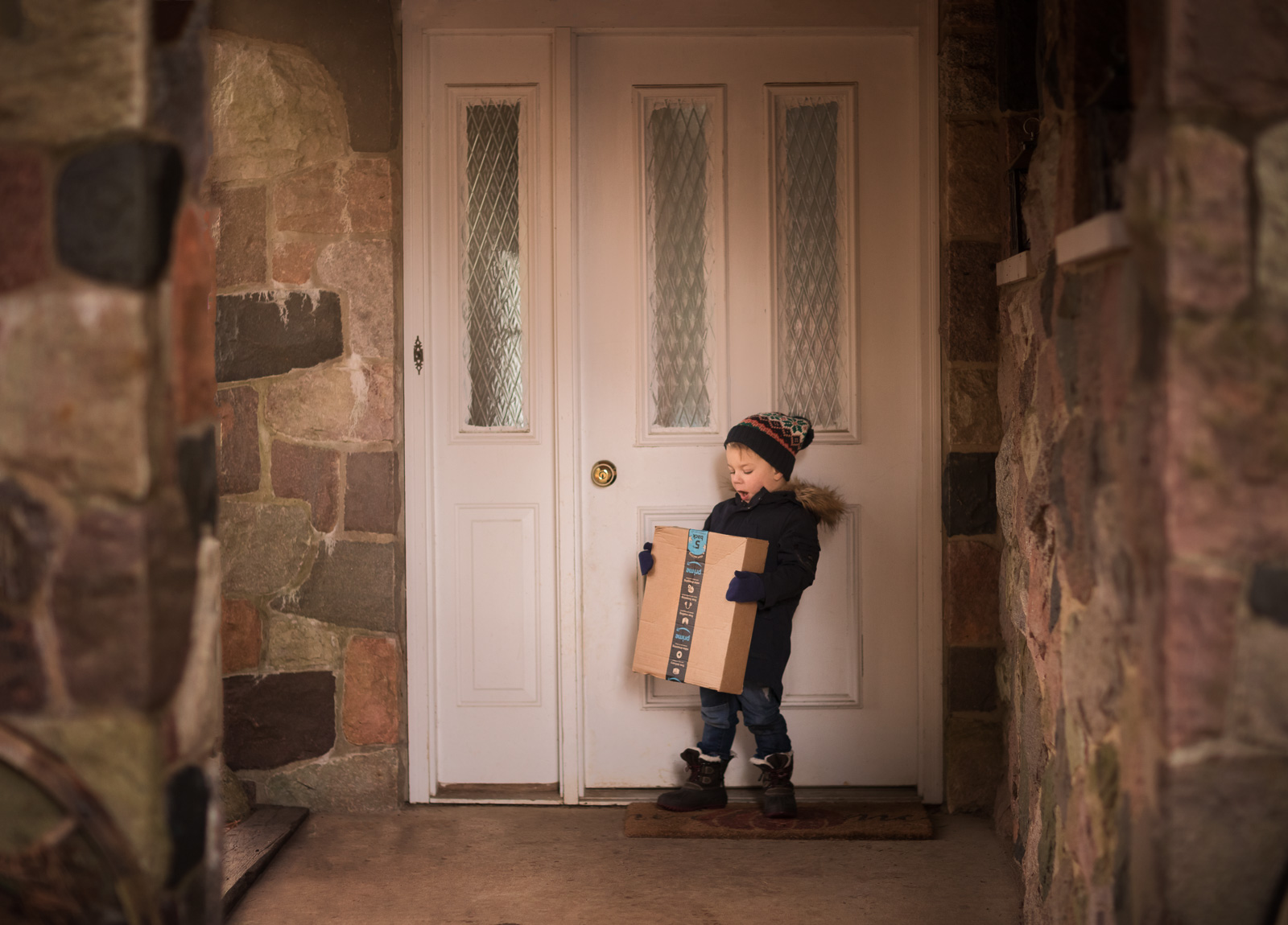 picture of boy holding an Amazon Prime box by Danielle Awwad