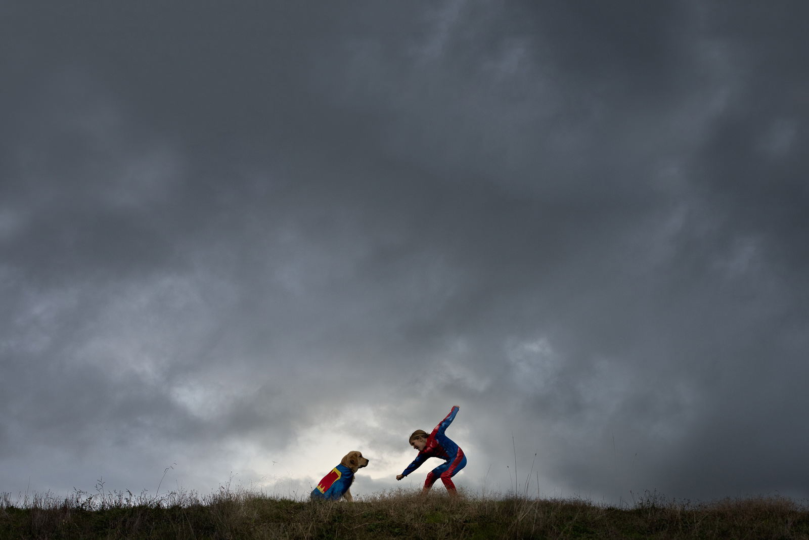 pic of child and dog dressed as superheros by Elle Walker