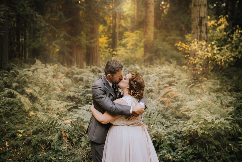 wedding photo of bride and groom kissing by Ebony Logins