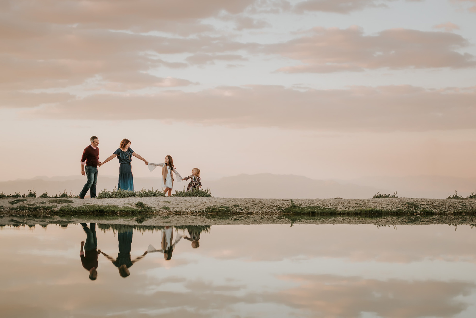 family photo with water reflection by Jamie Rubeis