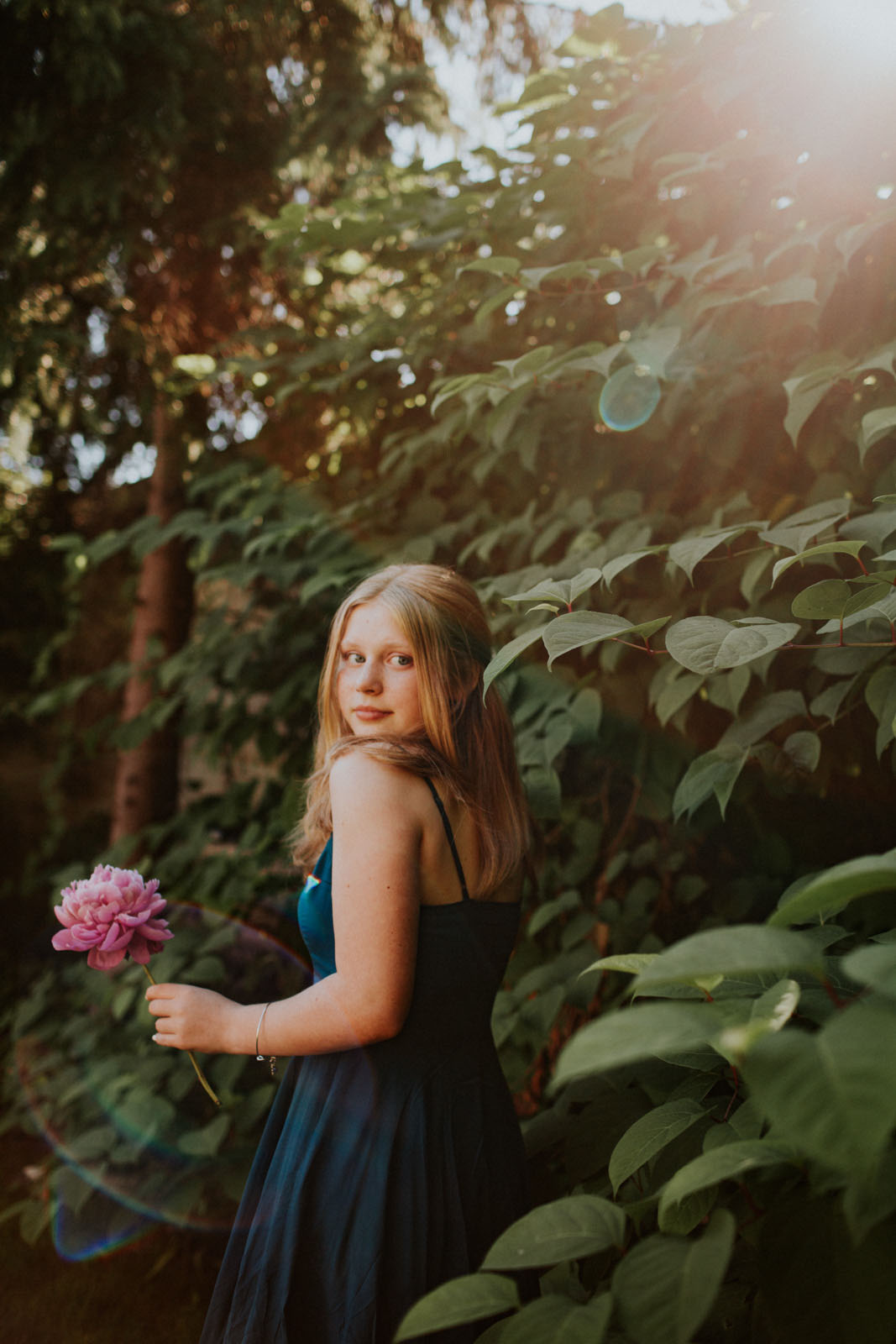 Including nature in your portraits is a great way to add interest. There are many ways to do so and I'm discussing four of them today!