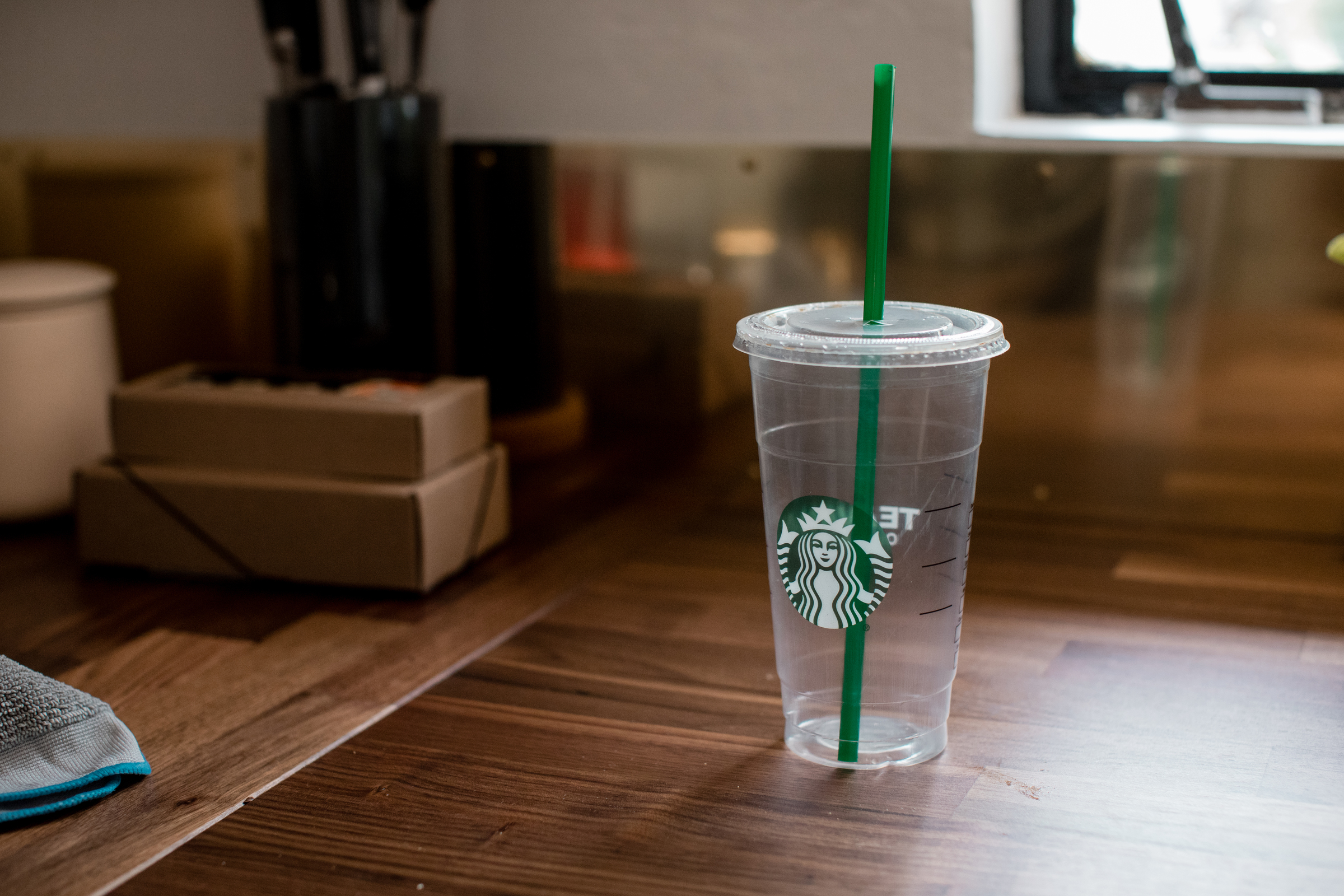 large Starbucks cold cup sitting on table