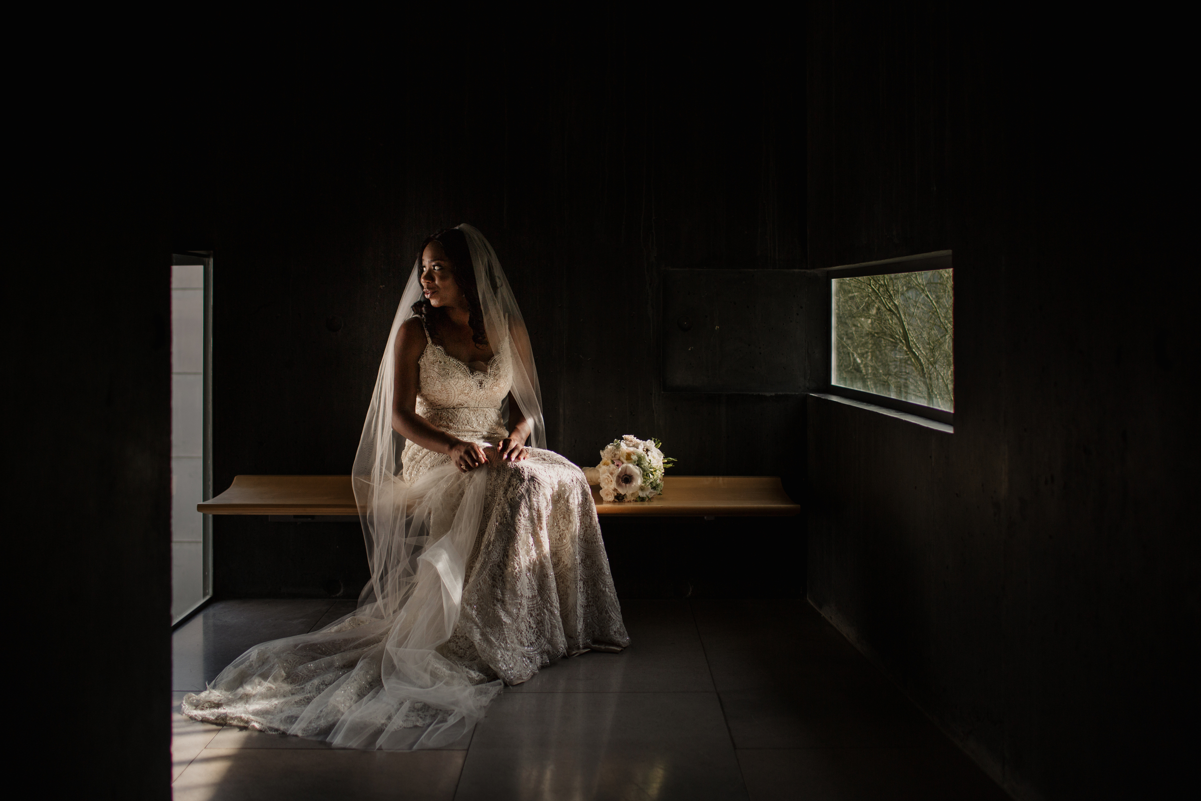 bride in gown sitting on bench