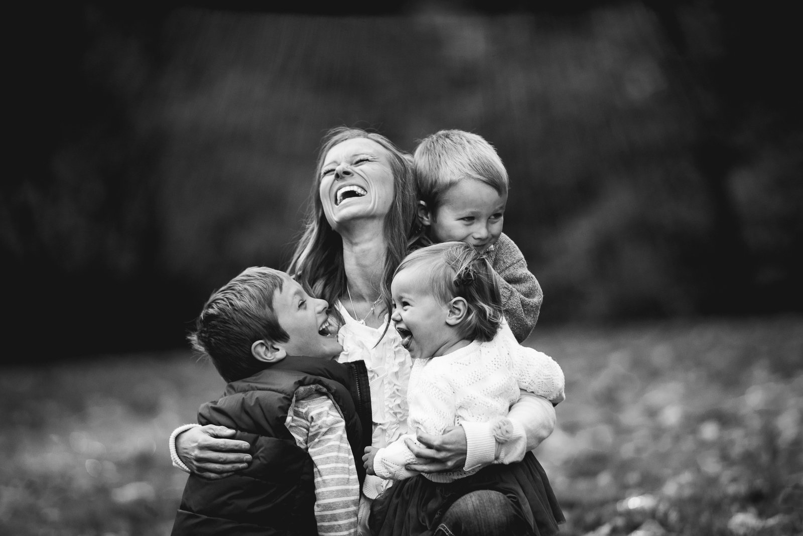 mother and children laughing