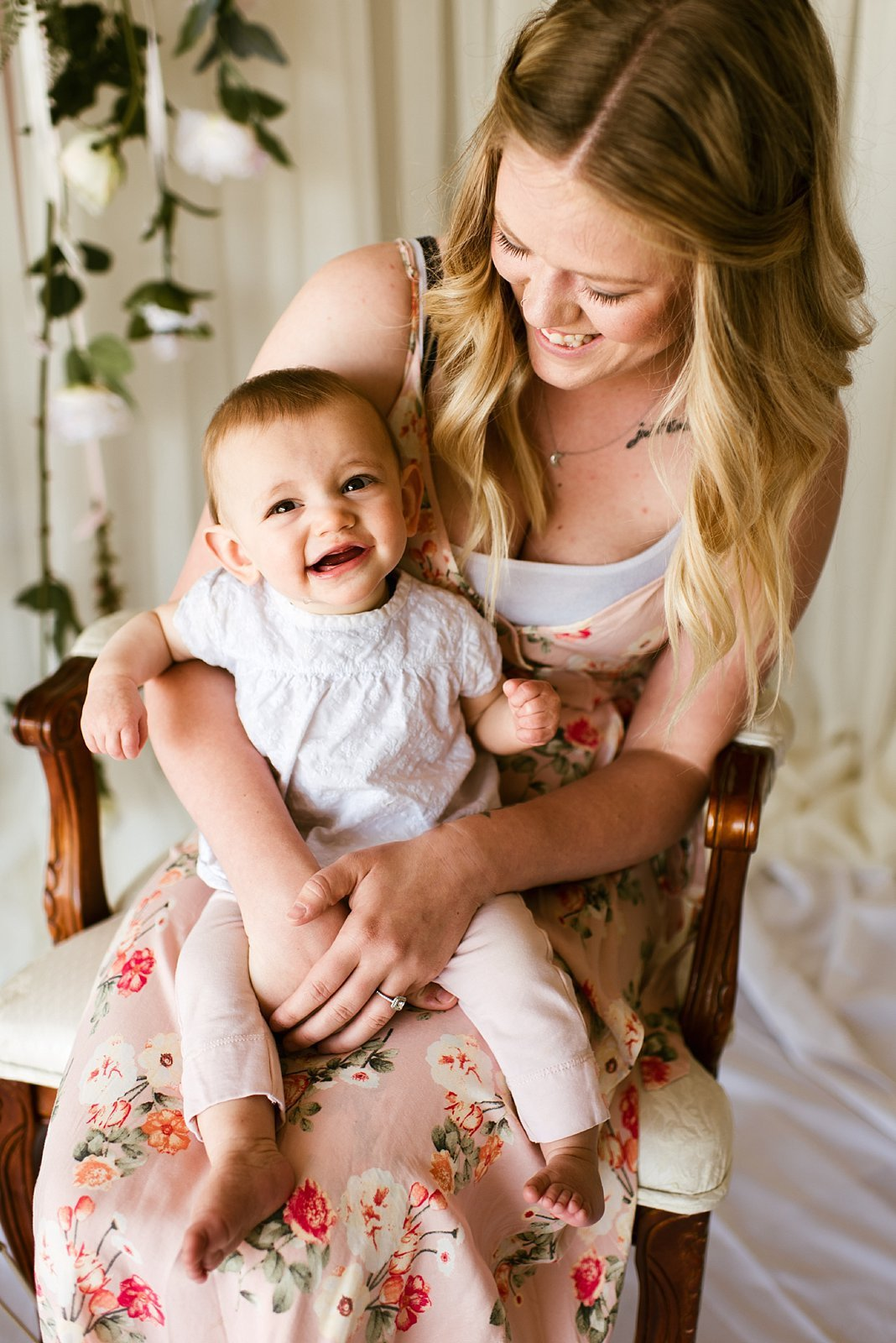 mother with child on lap smiling