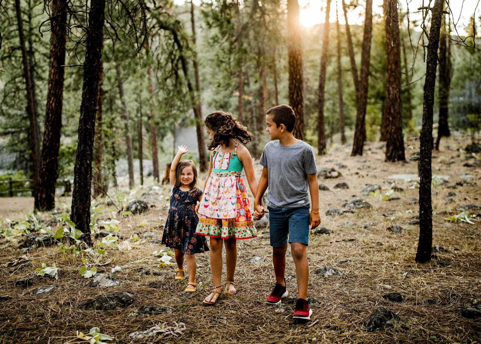 kids-walking-through-wooded-area-by-kelsey-farnham