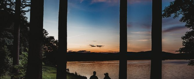 man-woman-holding-hands-sunset-silhouette-melissa-bissell