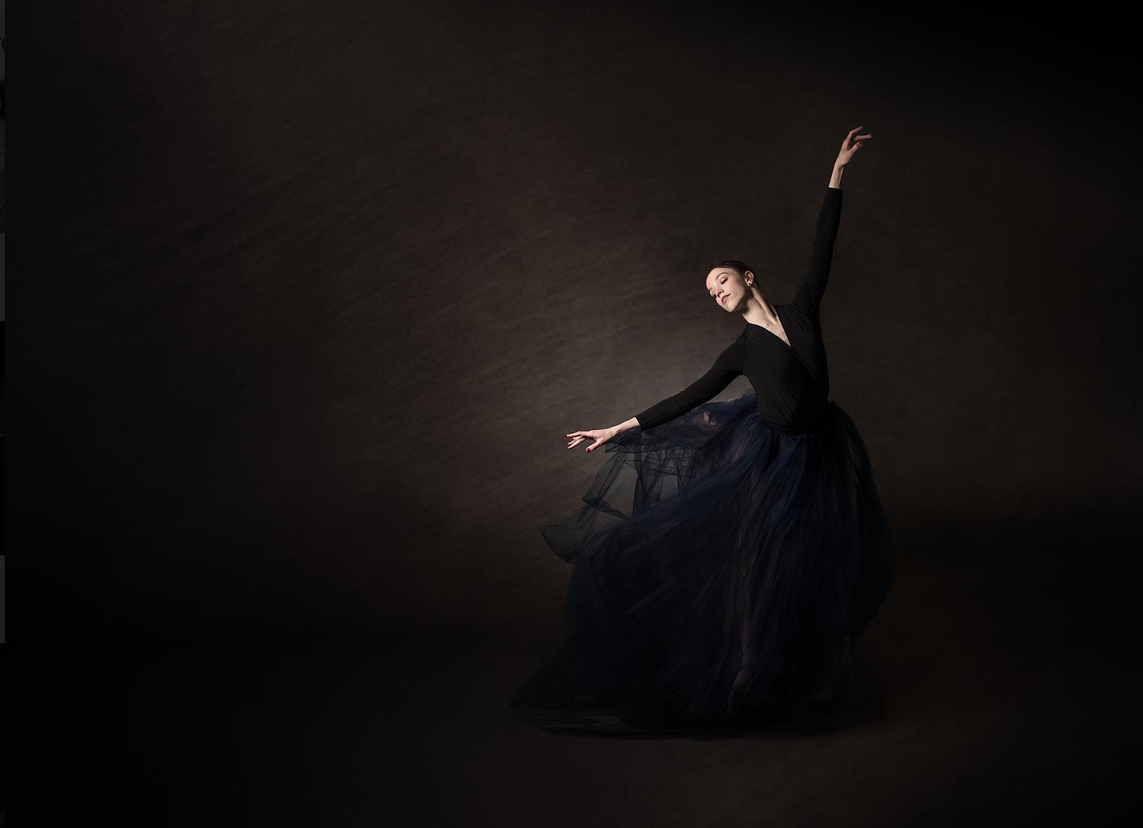 woman-black-dress-dancing-kate-luber-50mm-lens