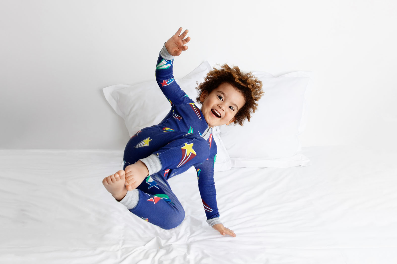 child-in-pajamas-jumping-on-bed-lisa-tichane
