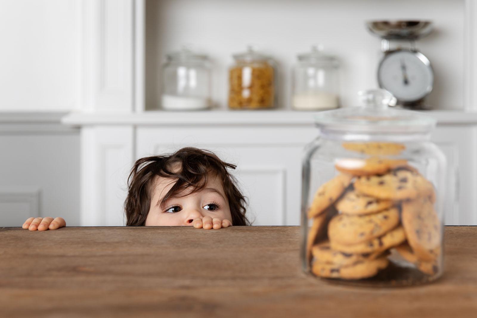 child-peeking-over-counter-at-cookie-jar-lisa-tichane