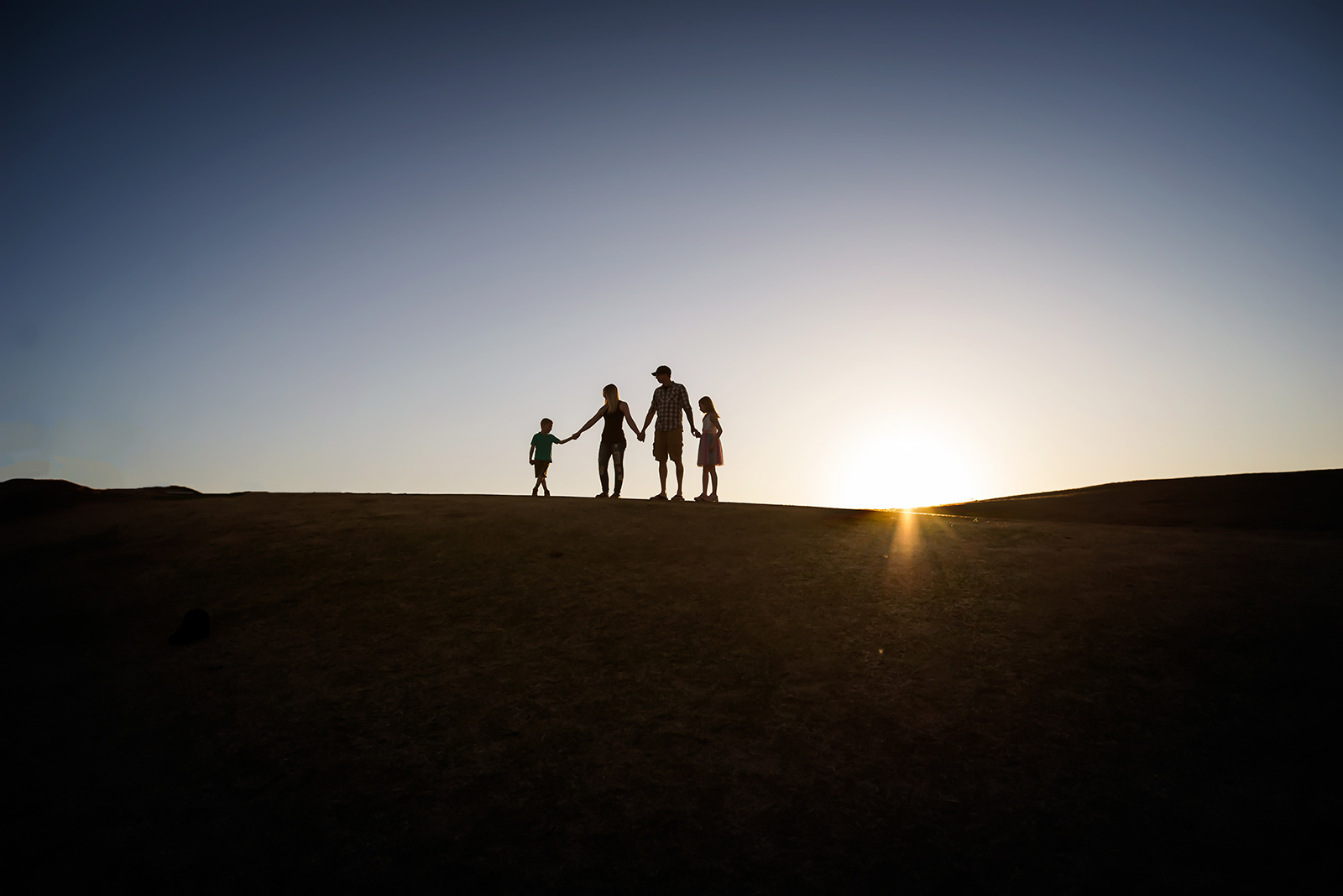 family-holding-hands-silhouette-Melissa-Richard21