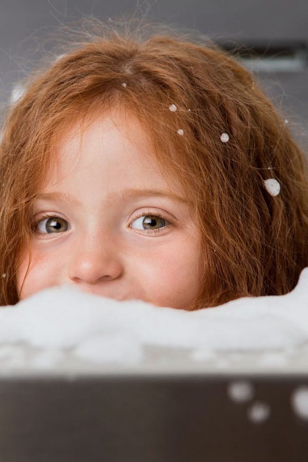 girl-peeking-out-from-bubble-bath-lisa-tichane