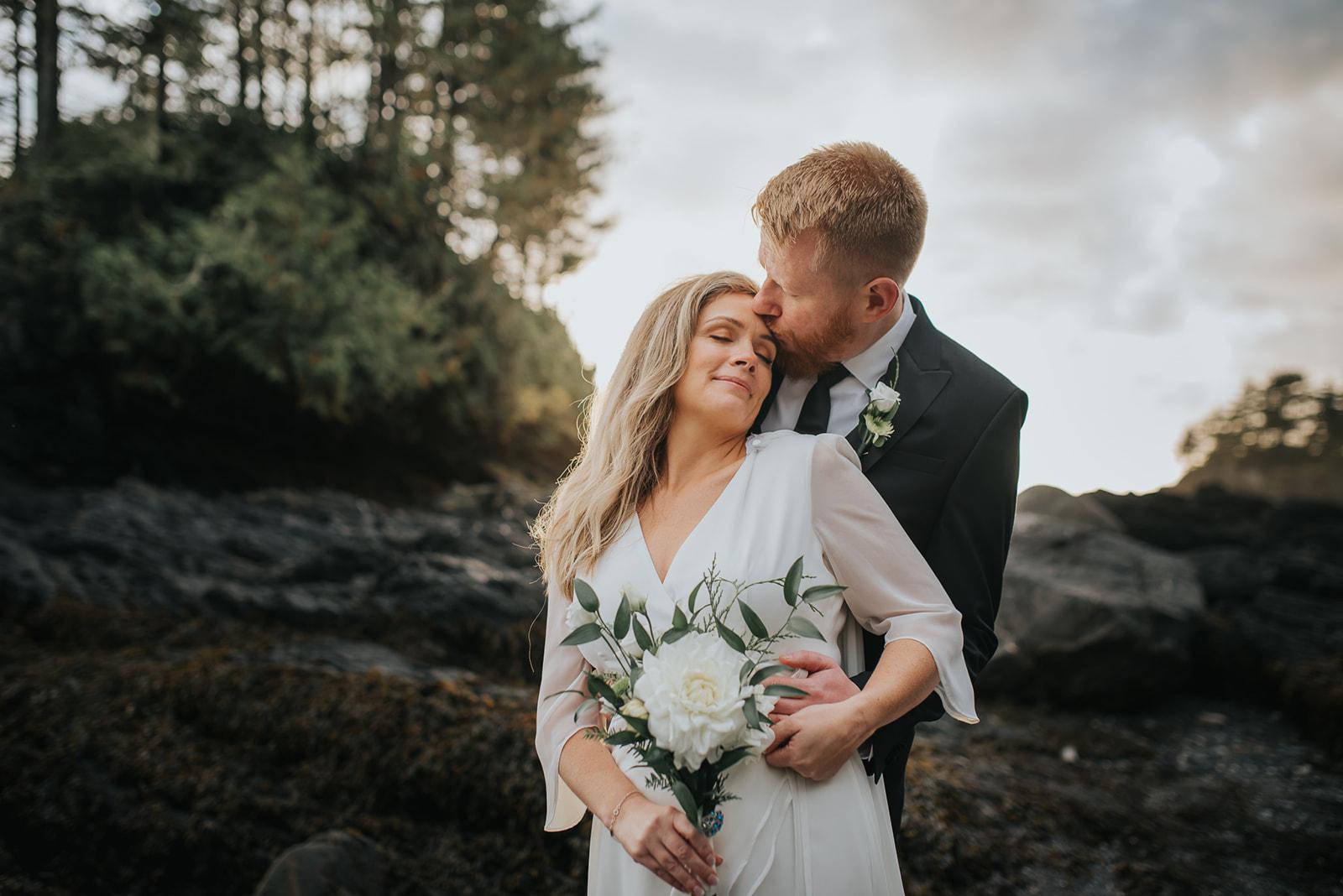 groom-kissing-brides-forehead