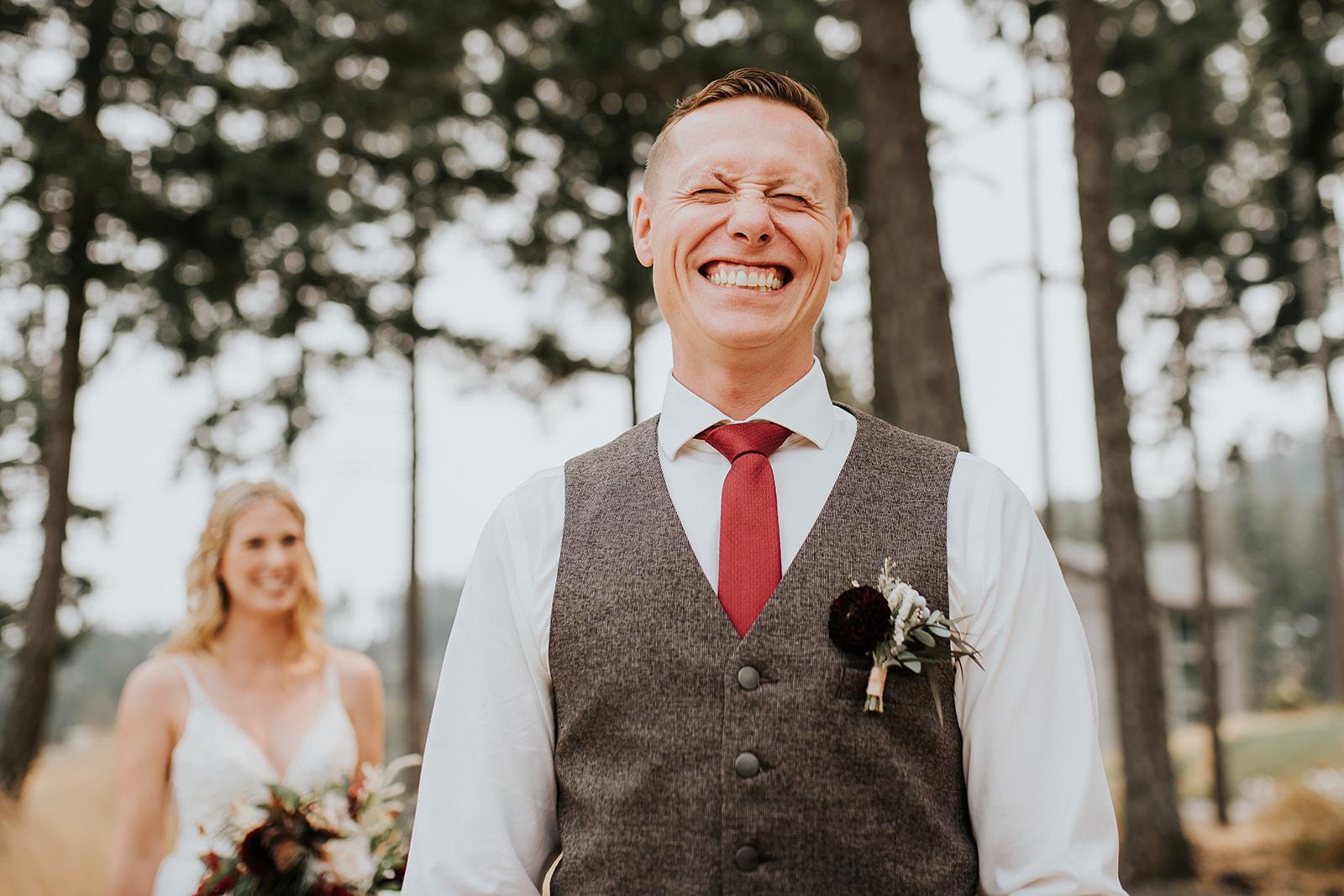 groom-smiling-waiting-to-see-bride-ebony-logins
