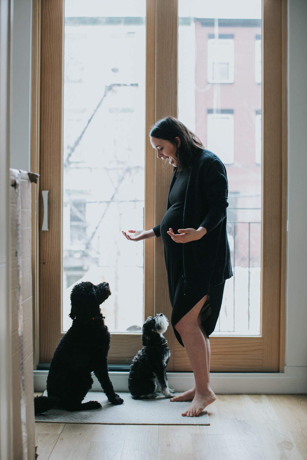 lifestyle intimate boudoir maternity photography mom talking to dogs amy hanen