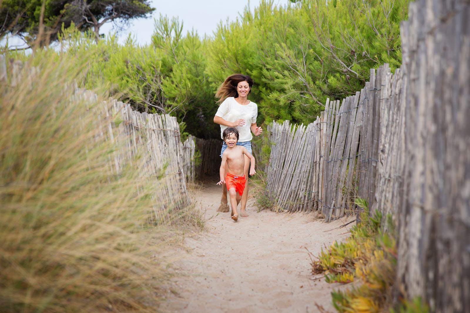 mother-and-son-running-down-beach-path-lisa-tichane