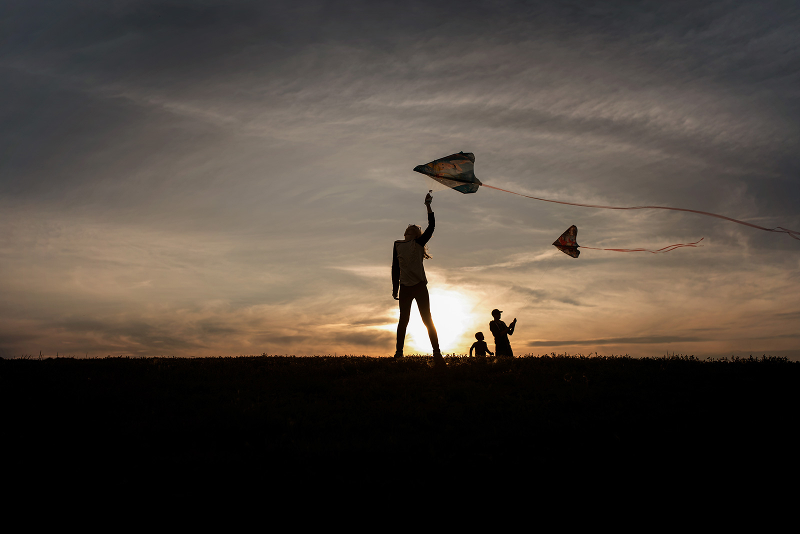 people-silhouette-kite-flying-Melissa-Richard
