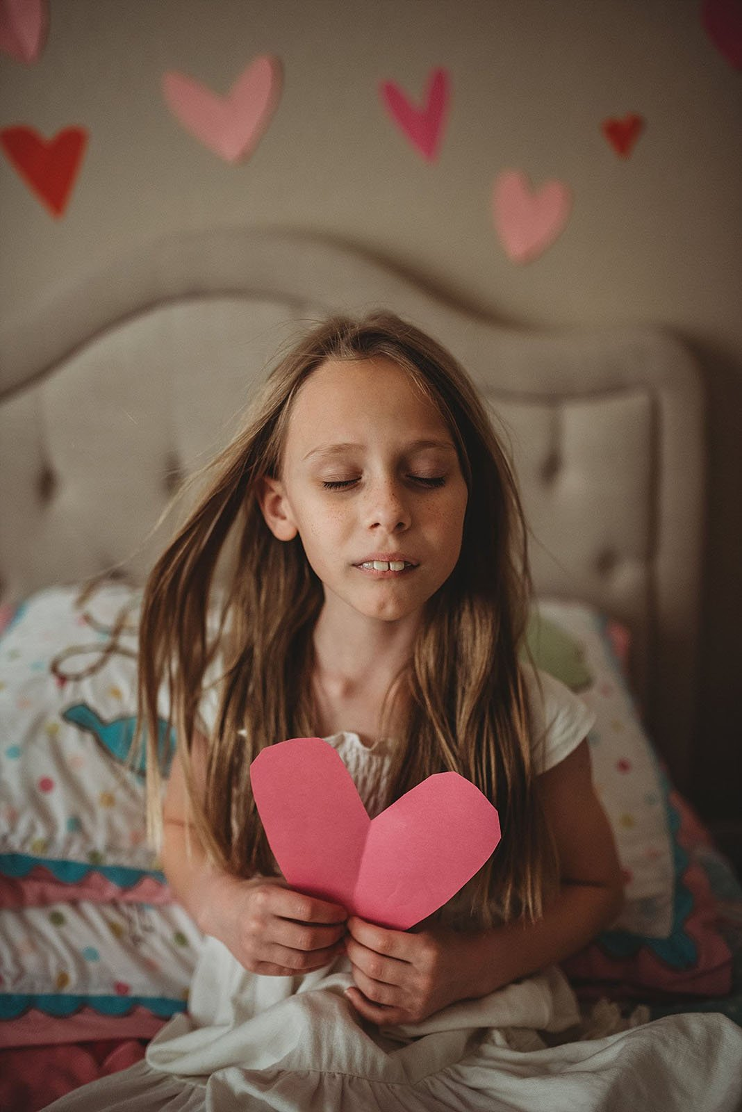Erica Williams-girl-holding-paper-heart_woodsywonders