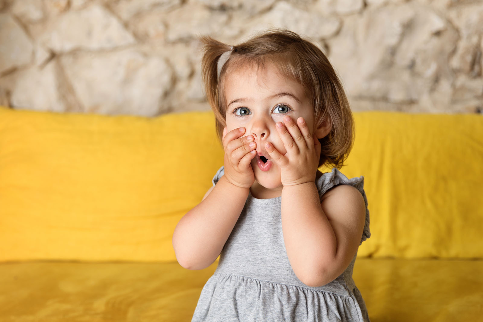 Image04 small girl giggling and covering mouth lisa tichane