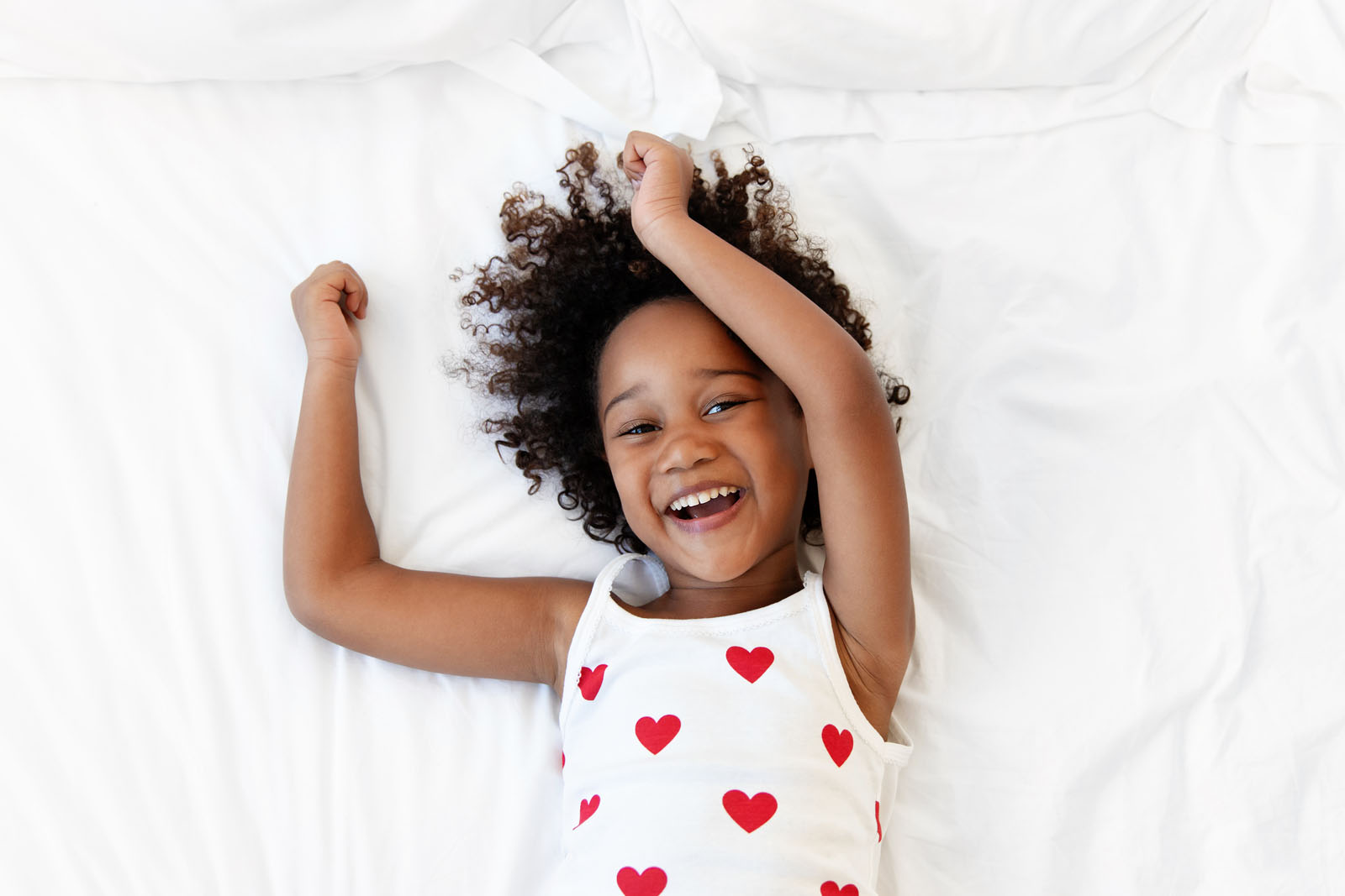 Image15 girl in heart shirt laying on bed smiling lisa tichane