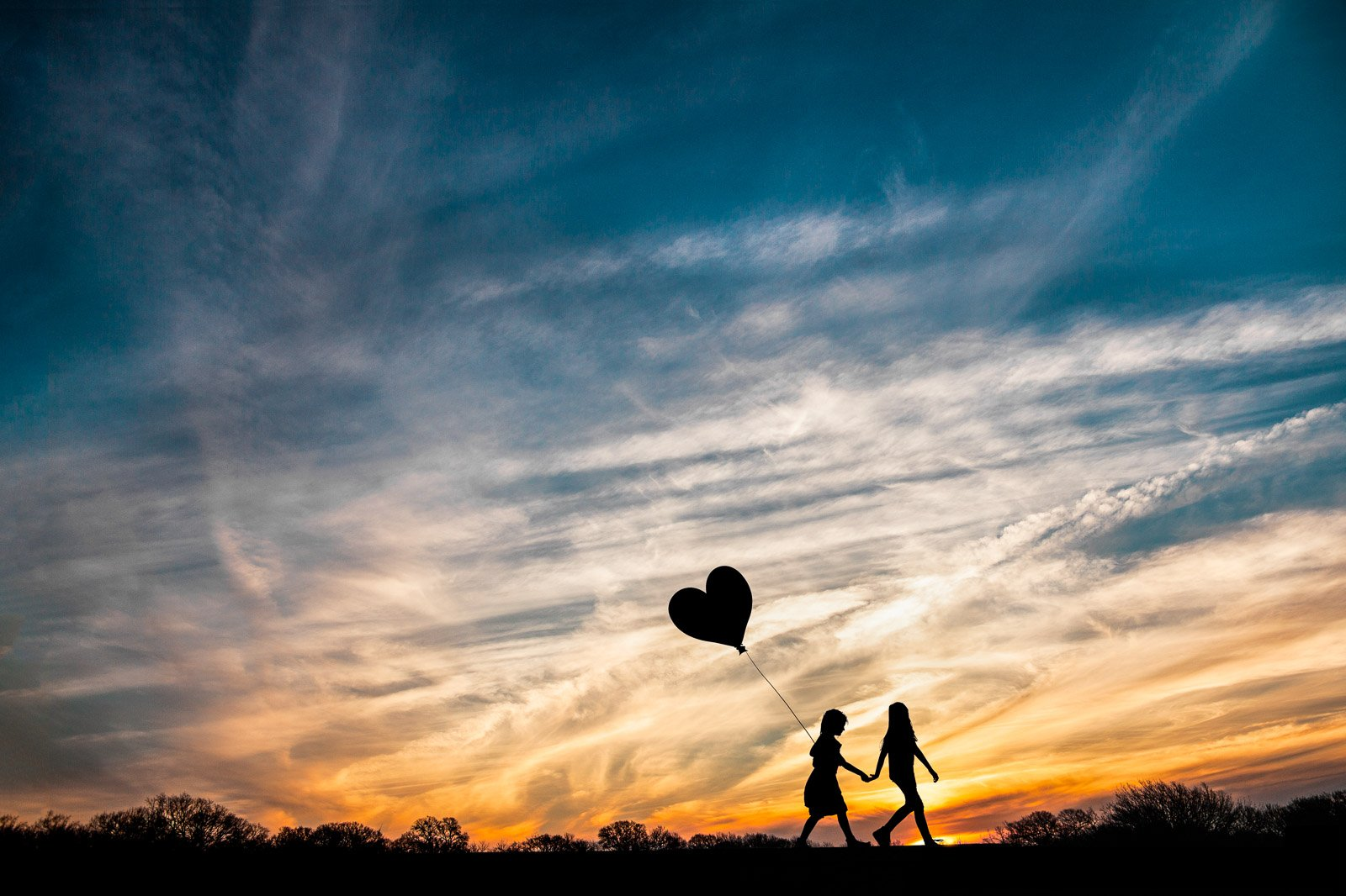 Jen Sebring-silhouette-kids-with-heart-balloon_jensebring