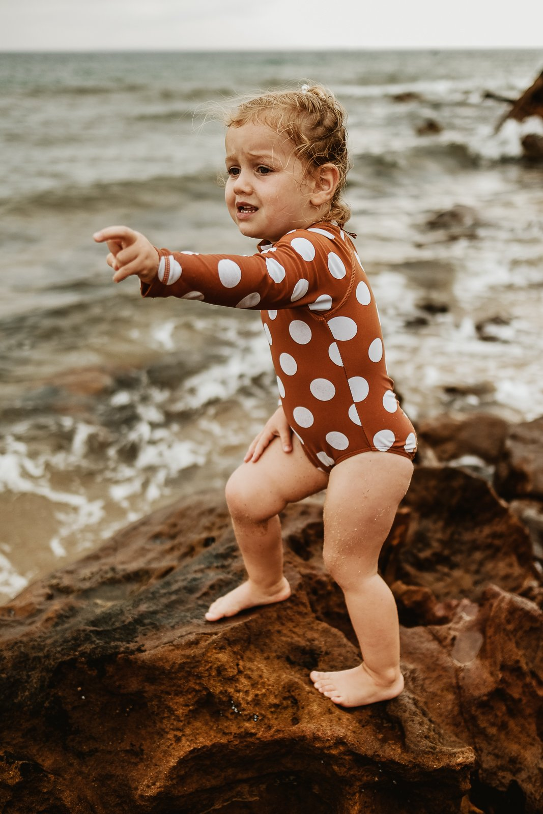 Julia_julia_cia clickin moms march forum photo contest toddler girl at the beach in polka dot swimsuit