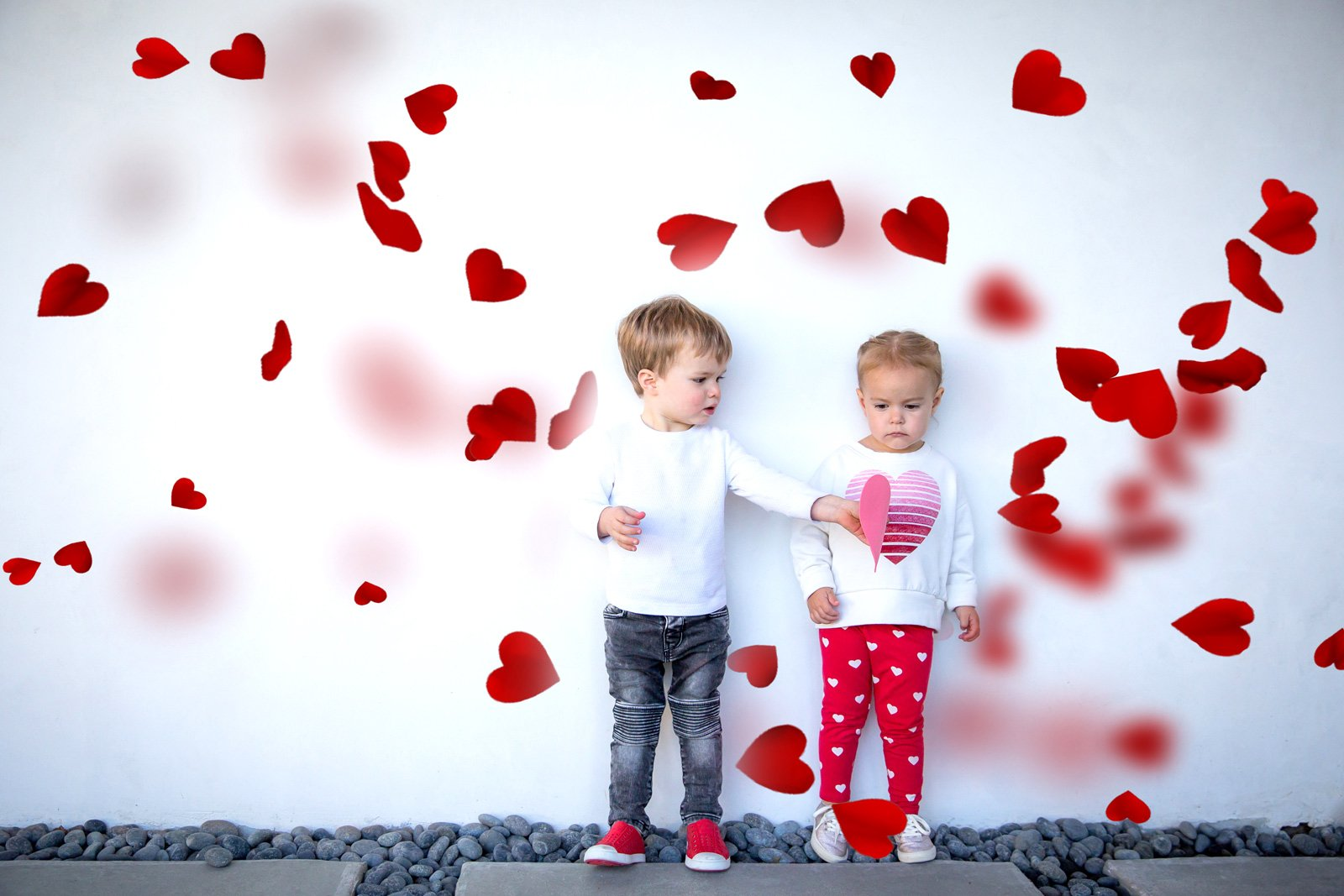 Nicole-varner-kids-standing-amongst-floating-hearts_nvarner