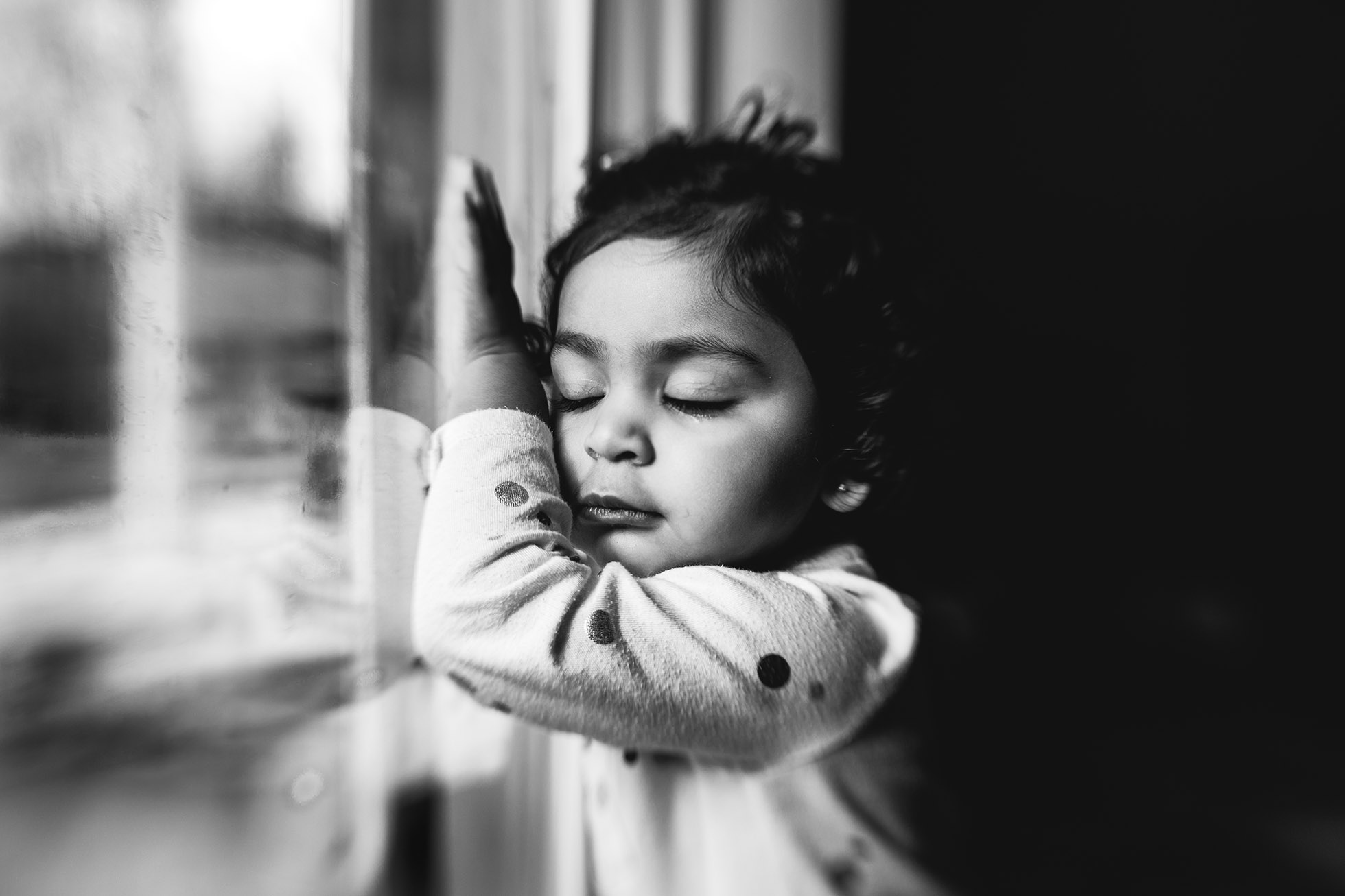 girl by window with eyes closed black and white jyo bhamadipati