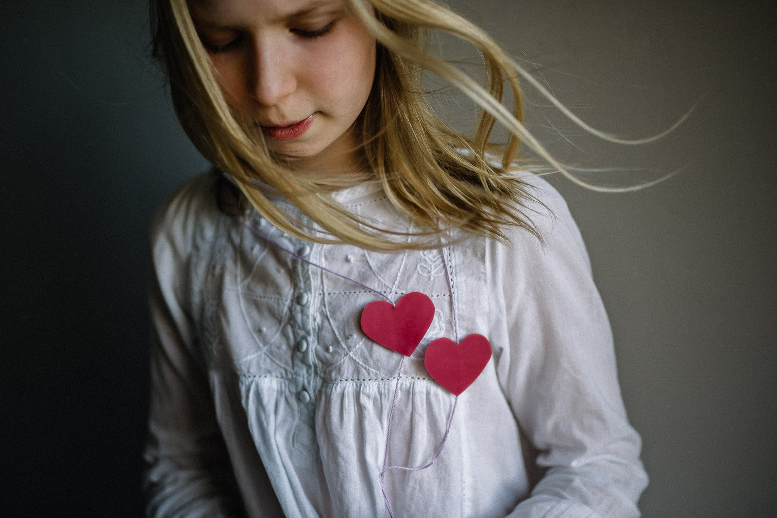Tania-girl-with-paper-hearts-on-shirt_taniad