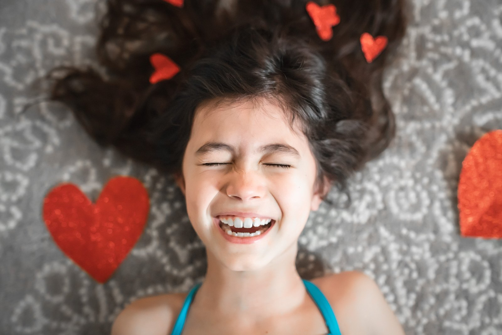 Tricia Pompilio-girl-laughing-with-hearts-in-hair-triciap