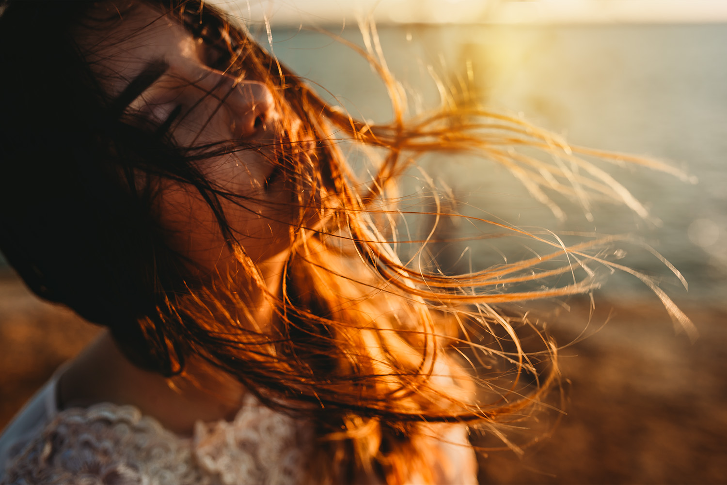 amber talbert_young girl with hair blowing in wind at sunset