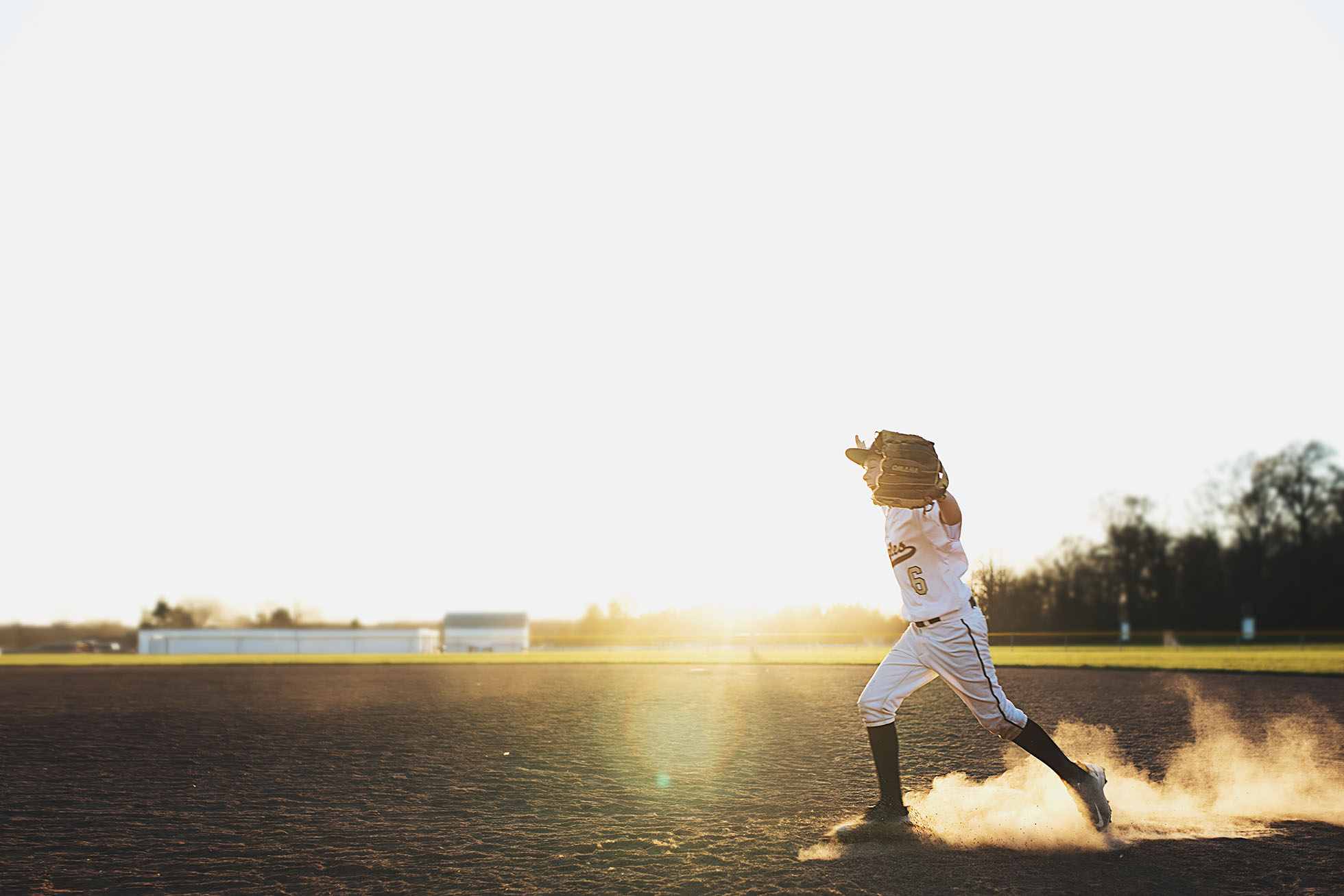 baseball player running across field freezing motion kellie bieser
